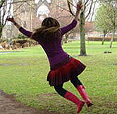 KIlted girl jumping