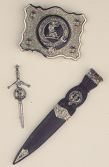 A matched set of belt buckle, sgian dubh and kilt pin all featuring a clan badge.
